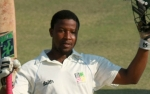 Tinotenda Mawoyo salutes after reaching his Maiden Test hundred