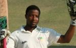 Tinotenda Mawoyo salutes after reaching his Maiden Test hundred