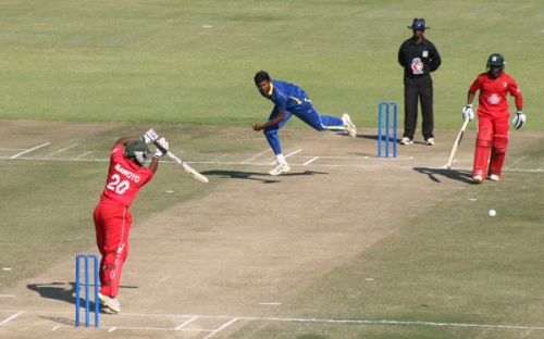 Tinotenda Mawoyo plays a shot against Sri Lanka