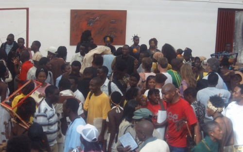 Art enthusiasts mingle with artsits and models at the exhibition