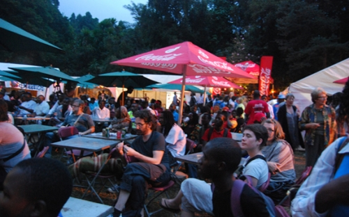 Festival goers relax at the Coca Cola Green