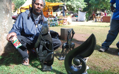 Sculptor with some of his work
