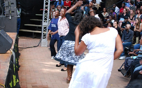 Rina Mushonga (in white) gets down at Hope Masikes show