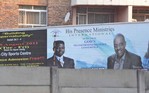 Divine intervention needed? Across the street behind Castle Corner at the intersection of Josiah Tongogara and 4th street, a billboard for a church conference promising supernatural growth