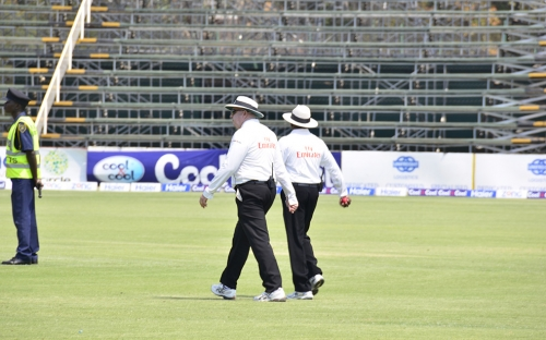 The two umpires Steve Davis  from Australia and Ranmore Martinesz from Sri Lanka walk out for a day in the sun.
