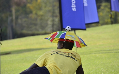 A fan with an umbrella hat.