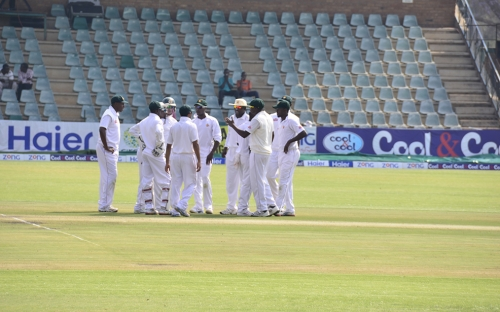 The team come together after the first wicket.