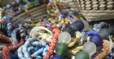 Recycled glass beads made into bracelets and necklaces