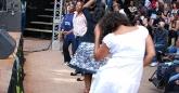Rina Mushonga (in white) gets down at Hope Masikes show