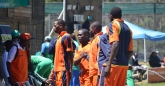 Stuart Matsikinyire congratulated by his team mates after scoring his first list A century