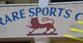 The Harare Sports Club logo, that lion looks spooked!