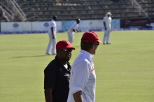 Coach Waller and his assistant Steve Mangongo have a chat as they walk around the field during play.