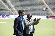 An ICC official walking around the pitch.